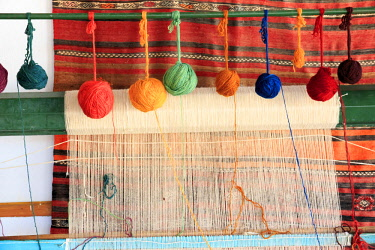 AS37EWI0714 Turkey, Izmir Province, Selcuk, weaving loom, rug making, balls of wool or yarn.