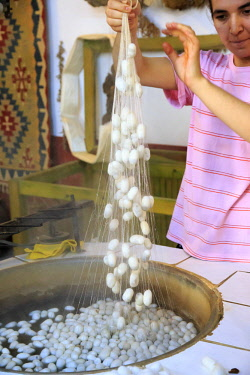 AS37EWI0715 Turkey, Izmir Province, Selcuk, processing silk cocoons in hot water. (Editorial Use Only)