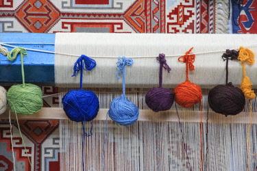 AS37EWI0719 Turkey, Izmir Province, Selcuk, weaving loom, rug making, balls of wool or yarn.