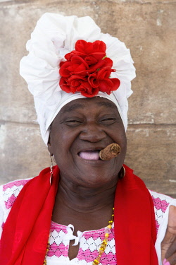 CA11BJY0060 Cuba, Havana, Old Havana. Woman with cigar.