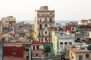 CA11BJY0113 Cuba, Havana. Building overviews and ocean.