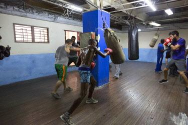 CA11BJY0156 Cuba, Havana. Boxers training in gym.