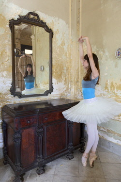 CA11BJY0184 Cuba, Havana. Portrait of ballerina reflection in mirror.