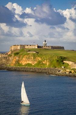 CA27BJN0047 Sailboat below fortress El Morro, San Juan, Puerto Rico