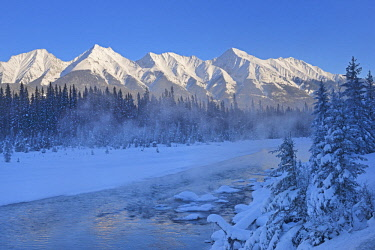 CN02BJY0231 Canada, British Columbia, Kootenay National Park. Mitchell Range and river in winter.