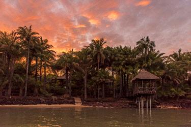 GUN0016AW Africa, Guinea Bissau. Bijagos Islands. Sunset on Rubane Island