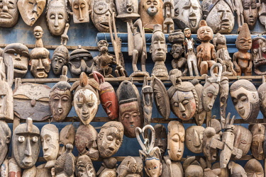 SEN1035AW Africa, Senegal, Dakar. Artisanal wooden masks outside the food market.
