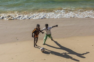 SEN1099AW Africa, Senegal, Saint-Louis. Children playing football on the beach of Saint-Louis.