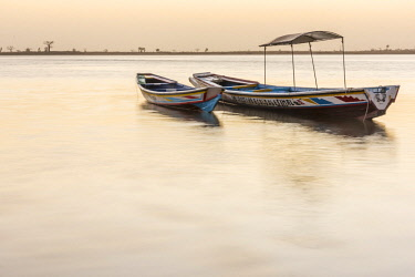 SEN1128AW Africa, Senegal, Sine-Saloum-Delta. Fishing boats at sunrise