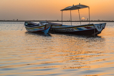 SEN1129AW Africa, Senegal, Sine-Saloum-Delta. Fishing boats at sunrise