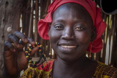SEN1135AW Africa, Senegal, Sine-Saloum-Delta. Market woman selling bracelets.