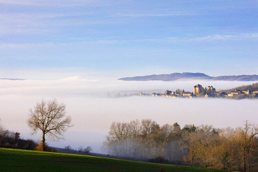 FRA10224AW Curemonte labelled l'un des plus beaux villages de France (most beautiful villages in France) in the morning mist, Correze, Nouvelle-Aquitaine, France