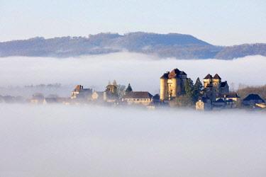 FRA10225AWRF Curemonte labelled l'un des plus beaux villages de France (most beautiful villages in France) in the morning mist, Correze, Nouvelle-Aquitaine, France