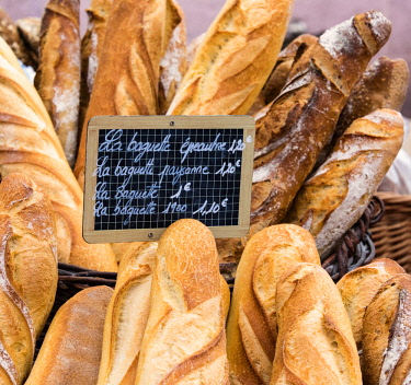 FRA10235AW Fresh bread sold at the local market in Colmar, Alsatian Wine Route, France