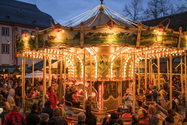 GER10610AW Carrousel on the Christmas market at the university square in Heidelberg, Baden-Wurttemberg, Germany