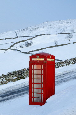 ENG15500AW England, North Yorkshire, Keld. Traditional red telephone box in winter landscape.