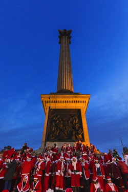 TPX63373 England, London, Trafalgar Square,Nelsons Column, People Dressed in Santa Costume