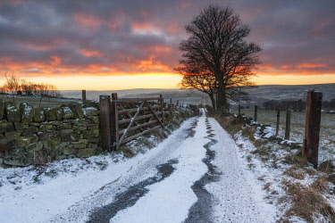 ENG15464AWRF England, West Yorkshire, Calderdale. A track and gate at sunset in winter.