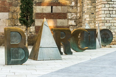 SPA7512AW Sculpture spellling the word Barcino (Latin name for Barcelona) by artist Joan Brossa in Placa Nova square, Gothic Quarter, Barcelona, Catalonia, Spain