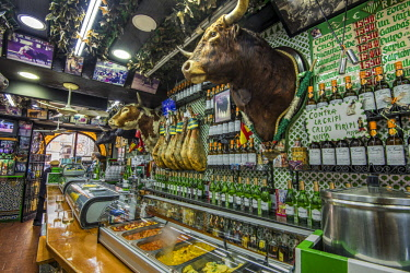 SPA7529AW Historical tapas bar adorned with traditional bullfighting memorabilia, Madrid, Community of Madrid, Spain