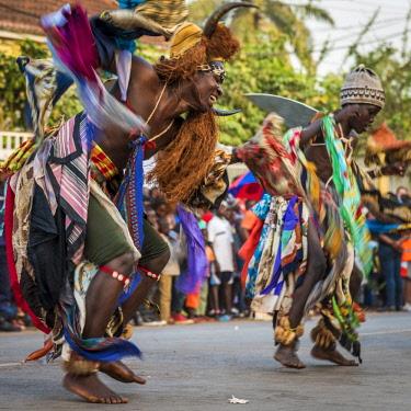 GUN0042AW Africa, Guinea Bissau. Bissau, masked dancer during the carnival