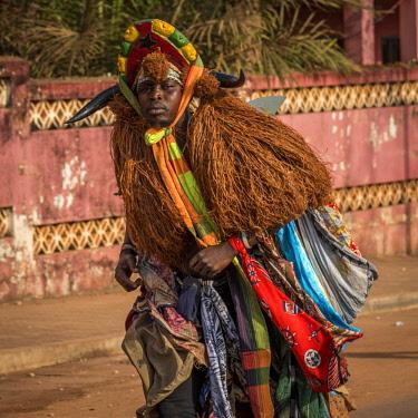 GUN0048AW Africa, Guinea Bissau. Bissau, mask during the carnival