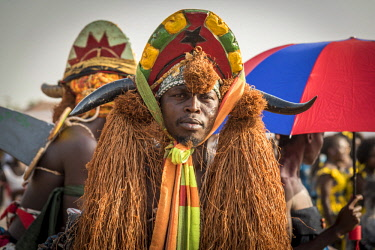 GUN0051AW Africa, Guinea Bissau. Bissau, mask during the carnival