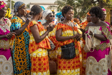 GUN0052AW Africa, Guinea Bissau. Bissau, ladies preparing for the parade of the Carnival
