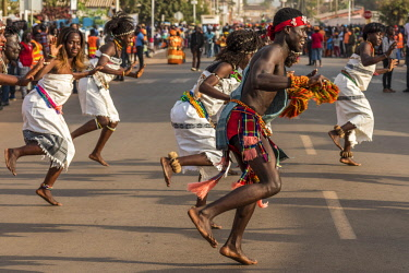 GUN0059AW Africa, Guinea Bissau. Bissau, group dancing during the Carnival's parade.