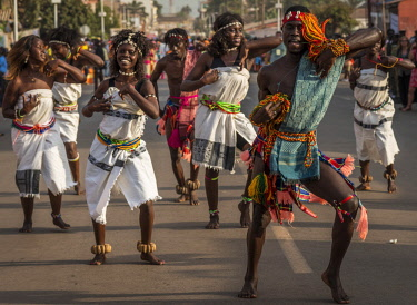 GUN0060AW Africa, Guinea Bissau. Bissau, group dancing during the Carnival's parade.