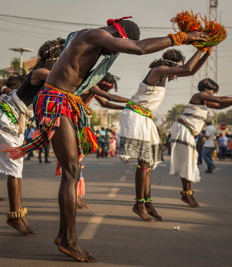GUN0061AW Africa, Guinea Bissau. Bissau, group dancing during the Carnival's parade.