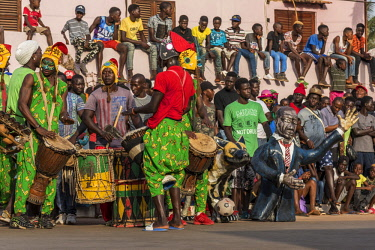 GUN0063AW Africa, Guinea Bissau. Bissau, spectators and musicians of the Carnival's parade.