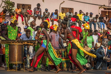 GUN0064AW Africa, Guinea Bissau. Bissau, spectators and musicians of the Carnival's parade.