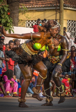 GUN0066AW Africa, Guinea Bissau. Bissau, dancing women during the Carnival's parade.