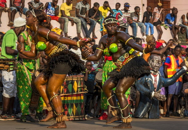 GUN0069AW Africa, Guinea Bissau. Bissau, dancing women during the Carnival's parade.