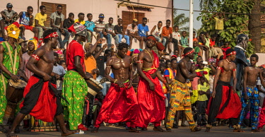 GUN0072AW Africa, Guinea Bissau. Bissau, group of men performing during the Carnival's parade.