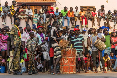 GUN0073AW Africa, Guinea Bissau. Bissau, spectators and musicians of the Carnival's parade.