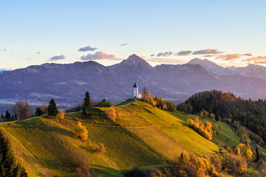 CLKAC82928 St. Primus and Felician church at sunrise. Jamnik, Kranj, Upper Carniola, Slovenia