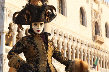 CLKDC80773 Typical mask of Carnival of Venice with Ducal Palace on background, Venice, Veneto, Italy