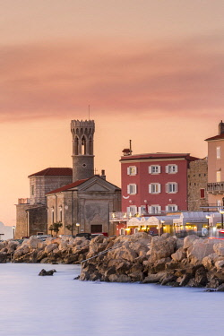 CLKGA80260 Promenade with church of St. Clement at sunset, Piran, Istria, Slovenia