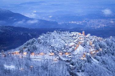 CLKMC81123 Evening view of the town of Santa Maria del Monte after a snowfall in winter from the Campo dei Fiori. Campo dei Fiori, Varese, Parco Campo dei Fiori, Lombardy, Italy.