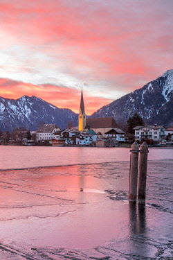 CLKMG83543 Winter sunrise in Rottach-Egern with the frozen Tegernsee Lake, District Miesbach, Upper Bavaria, Germany, Europe