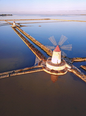 CLKRM82479 Aerial view of salt flats and windmills, Saline dello Stagnone, Marsala, province of Trapani, Sicily, Italy