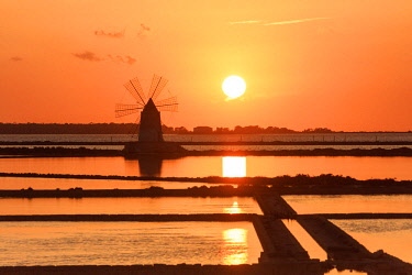 CLKRM82488 Windmill at sunset, Saline dello Stagnone, Marsala, province of Trapani, Sicily, Italy