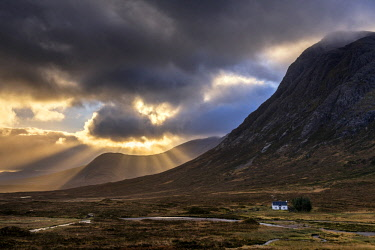 SCO35244AW Sun Beams Through Clouds and Lone Cottage, Glen Coe, Highland Region, Scotland