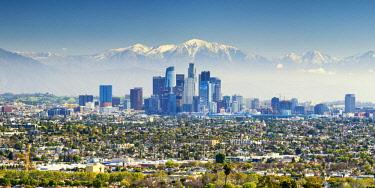 USA13189AW Los Angeles Skyline and Snow Capped San Gabriel Mountains, California, USA