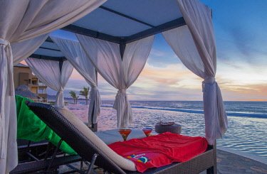 SA13JME0555 Mexico, Baja California Sur, Todos Santos, Cerritos Beach, lounge chairs under canopy on beach. (PR)