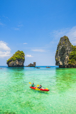 THA1290AW Ao Nui (Nui Beach), Ko Phi Phi Don, Krabi Province, Thailand. Tourists kayaking in the turquoise waters.