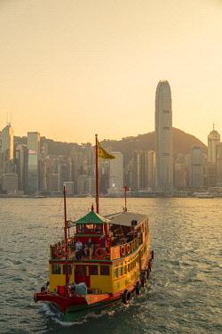 CH11533AWRF Tour boat in Victoria Harbour at sunset, Hong Kong Island, Hong Kong