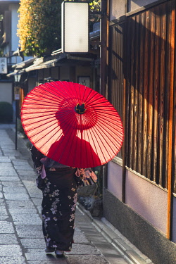 JAP1384AW Woman in kimono walking along alleyway, Kyoto, Kansai, Japan (MR)